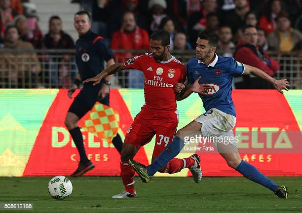 Benfica's midfielder from morocco Carcela with Os Belenenses' forward Fabio Nunes in action during the Primeira Liga match between Os Belenenses and...