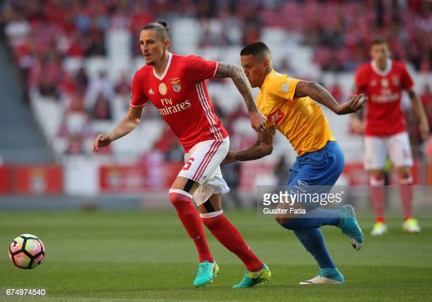 Benfica's midfielder from Serbia Ljubomir Fejsa with Estoril's midfielder Carlinhos from Brazil in action during the Primeira Liga match between SL...