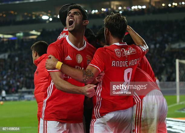 Benfica's midfielder Goncalo Guedes and SL Benfica's midfielder Andre Horta celebrates after teammate SL Benfica's defender from Argentina Lisandro...