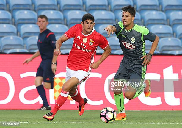 Benfica's midfielder Goncalo Guedes with Vitoria Setubal's defender Fabio Cardoso in action during the Algarve Football Cup Pre Season Friendly match...