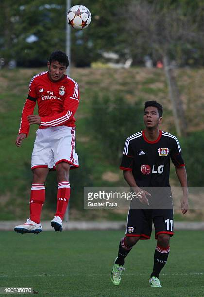 Benfica's midfielder Joao Carvalho jumps close to Bayer Leverkusen's midfielder Benjamin Henrichs during the UEFA Youth League match between SL...