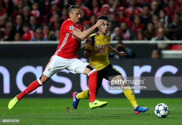 Benfica's midfielder Ljubomir Fejsa from Serbia vies with Dortmund's defender Raphael Guerreiro from Portugal during SL Benfica v Borussia Dortmund...