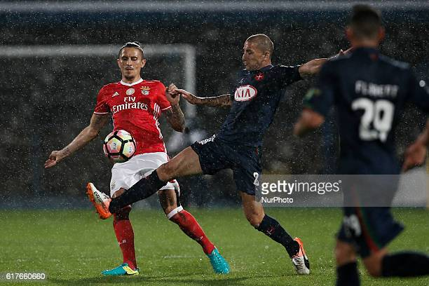 Benfica's midfielder Ljubomir Fejsa vies for the ball with Belenenses's midfielder Andre Sousa during Premier League 2016/17 match between CF...