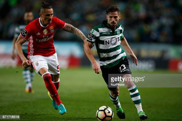 Benfica's midfielder Ljubomir Fejsa vies for the ball with Sporting's midfielder Adrien Silva during Premier League 2016/17 match between Sporting CP...