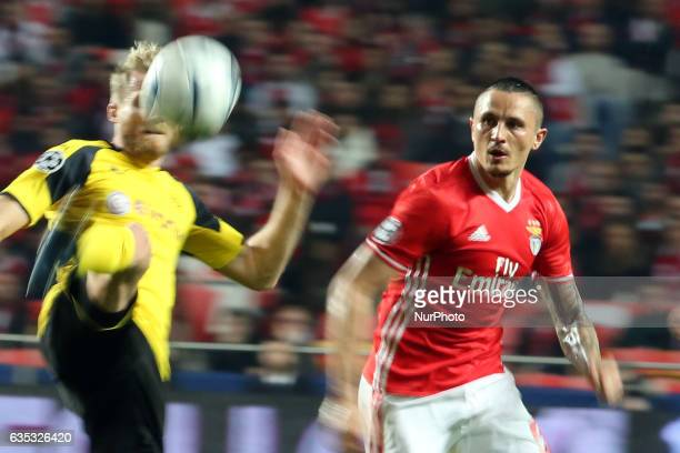 Benfica's midfielder Ljubomir Fejsa vies with Dortmund's forward Andre Schurrle during the UEFA Champions League round of 16 first leg football match...