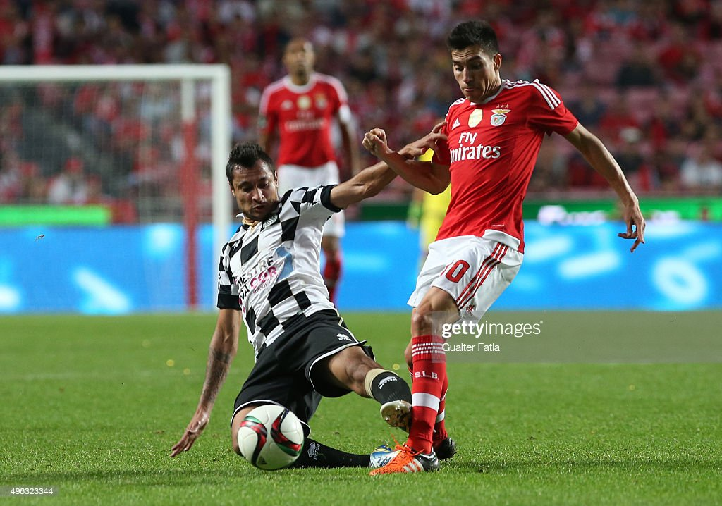 SL BenficaÕs midfielder Nico Gaitan with BoavistaÕs defender Anderson Correia in action during the Primeira Liga match between SL Benfica and Boavista at Estadio da Luz on November 8, 2015 in Lisbon, Portugal.