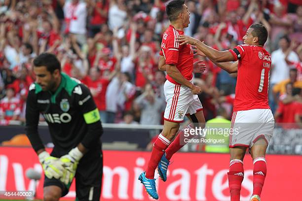 Benfica's midfielder Nicolas Gaitan and Benfica's forward Lima celebrates Benfica's goal during the Primeira Liga match between SL Benfica and...