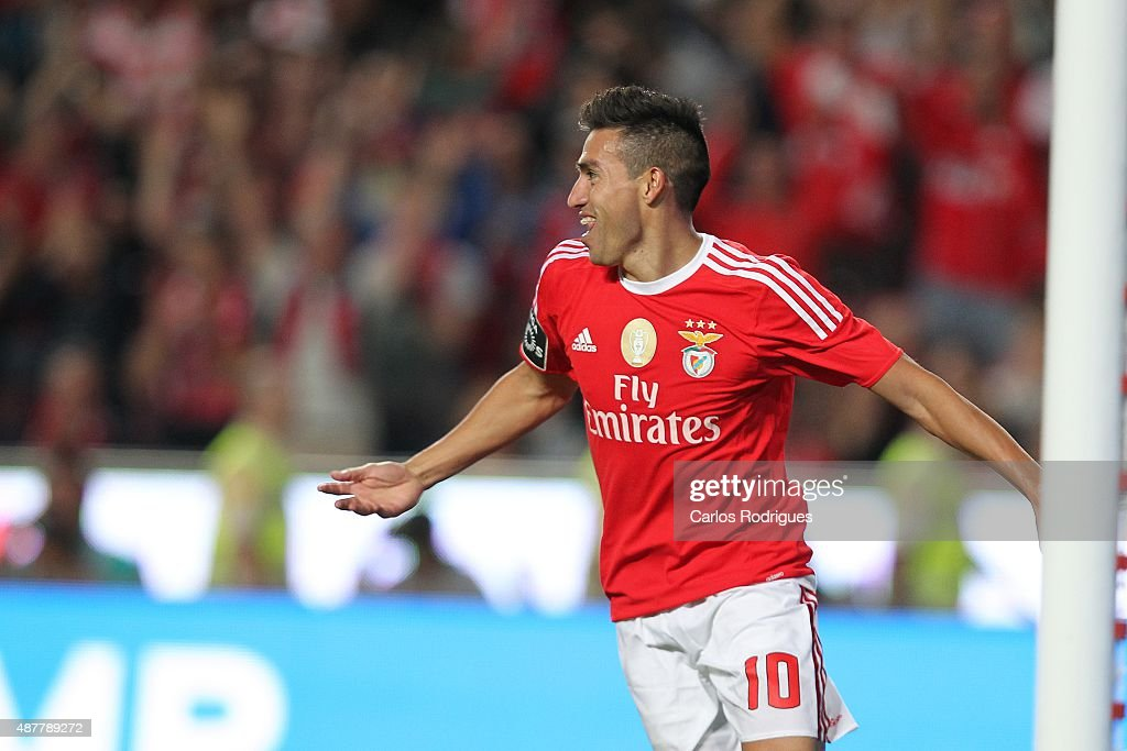 Benfica's midfielder <a gi-track='captionPersonalityLinkClicked' href=/galleries/search?phrase=Nicolas+Gaitan&family=editorial&specificpeople=5538639 ng-click='$event.stopPropagation()'>Nicolas Gaitan</a> celebrates scoring Benfica's fifth goal during the match between SL Benfica and CF Belenenses at Estadio da Luz on September 11, 2015 in Lisbon, Portugal.
