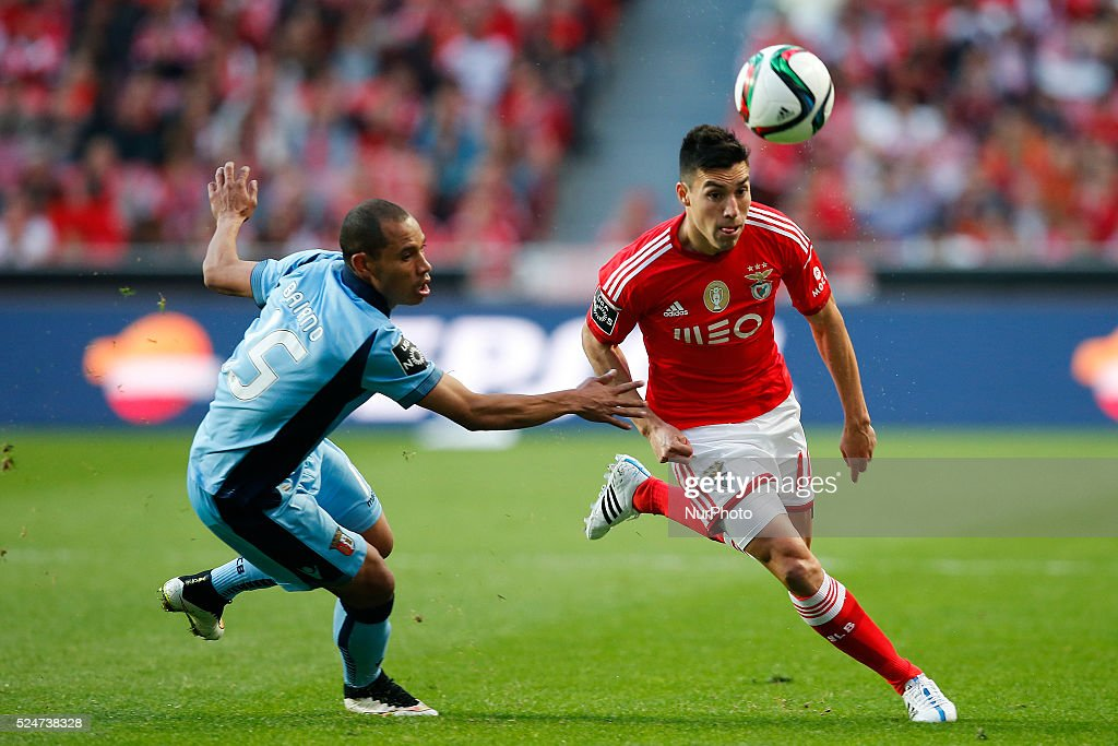 Benfica's midfielder Nicolas Gaitan vies for the ball with Braga's defender Baiano during the Portuguese League football match between SL Benfica and...