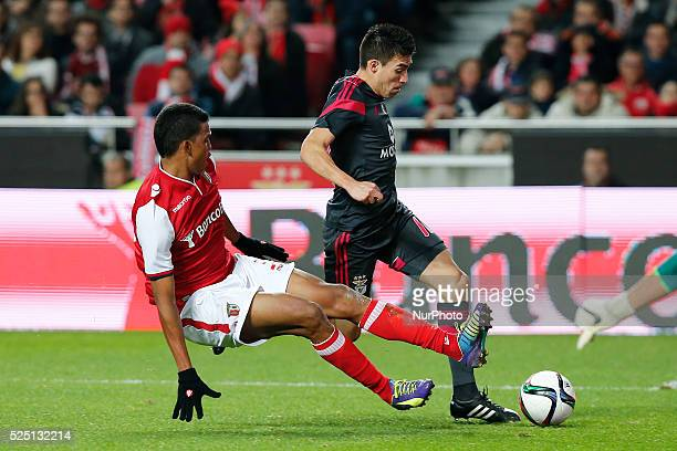 Benfica's midfielder Nicolas Gaitan vies for the ball with Braga's defender Aderlan Santos during the Portuguese Cup football match between SL...