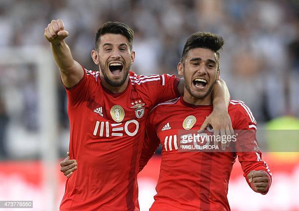 Benfica's midfielder Pizzi and Argentinian forward Eduardo Salvio celebrate at the end of the Portuguese league football match Vitoria SC vs SL...