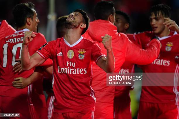 Benfica's midfielder Pizzi celebrates the goal scored by teammate Mexican forward Raul Jimenez during the Portuguese league football match Rio Ave FC...