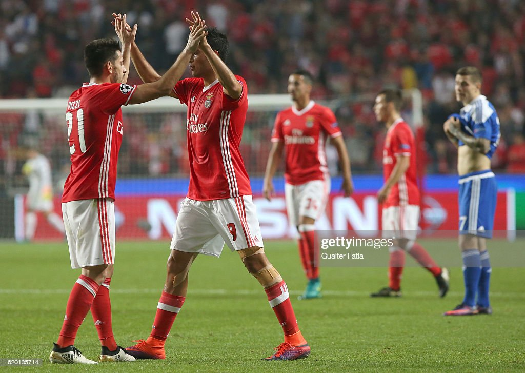 SL Benfica's midfielder Pizzi celebrates with teammate SL Benfica's forward from Mexico Raul Jimenez the victory at the end of the UEFA Champions League match between SL Benfica and FC Dynamo Kyiv at Estadio da Luz on November 1, 2016 in Lisbon, Portugal.