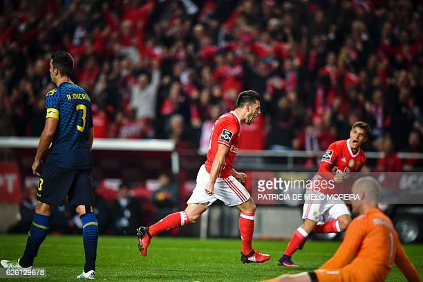 Benfica's midfielder Pizzi Fernandes celebrates after scoring a goal during the Portuguese league football match SL Benfica vs Moreirense FC at the...