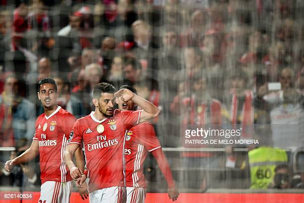 Benfica's midfielder Pizzi Fernandes celebrates after scoring during the Portuguese league football match SL Benfica vs Moreirense FC at the Luz...