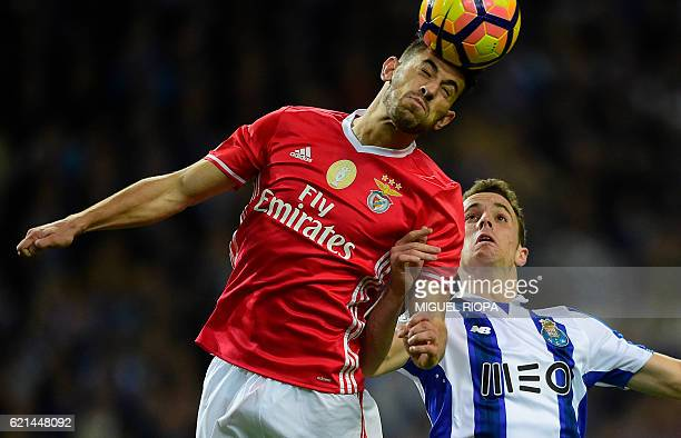 Benfica's midfielder Pizzi heads the ball with Porto's forward Diogo Jota during the Portuguese league football match FC Porto vs SL Benfica at the...