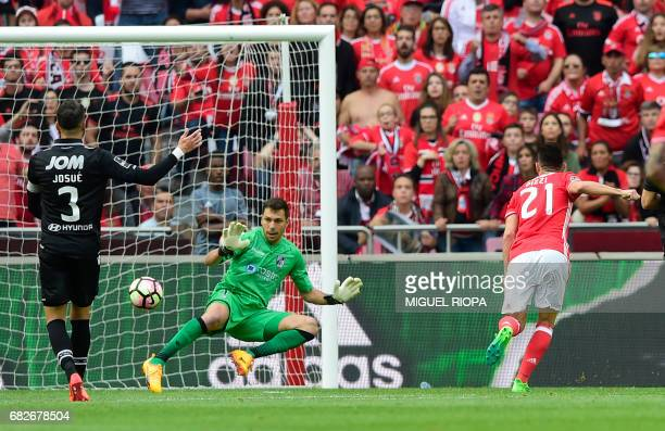 Benfica's midfielder Pizzi scores during the Portuguese league football match SL Benfica vs Vitoria Guimaraes SC at the Luz stadium in Lisbon on May...
