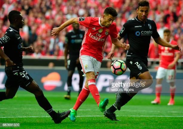 Benfica's midfielder Pizzi tries to score a goal next to Vitoria Guimaraes' Ivorian defender Ghislain Konan and Brazilian defender Pedro Henrique...