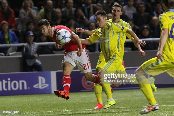 Benfica's midfielder Pizzi vies for the ball with Astana's Kazakh midfielder Serikzhan Muzhikov during the UEFA Champions League group C football...