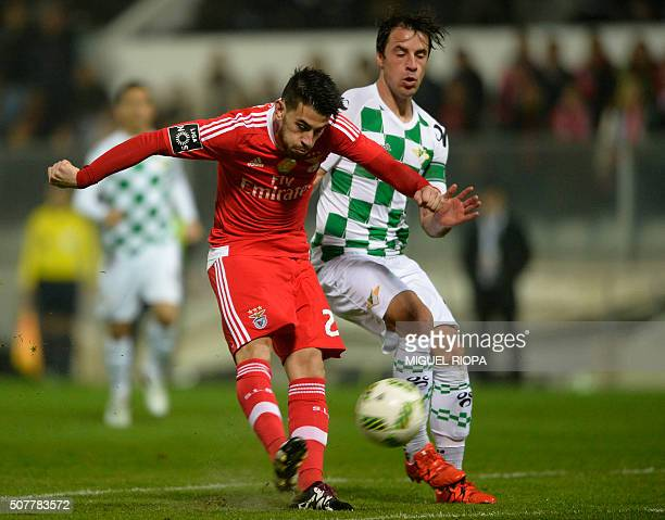 Benfica's midfielder Pizzi vies with Moreirense's midfielder Vitor Gomes during the Portuguese league football match Moreirense FC vs SL Benfica at...
