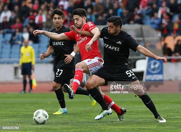 Benfica's midfielder Pizzi with A Academica de Coimbra's defender Rafa Soares in action during the Primeira Liga match between A Academica de Coimbra...