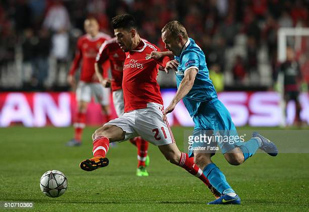 Benfica's midfielder Pizzi with FC Zenit's defender Aleksandr Anyukov in action during the UEFA Champions League Round of 16 First Leg match between...
