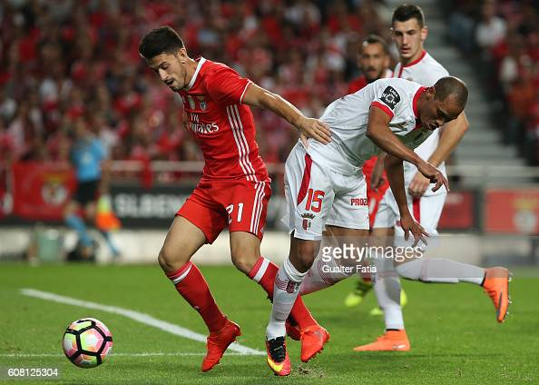 Benfica's midfielder Pizzi with SC Braga's Brazilian defender Baiano in action during the Primeira Liga match between SL Benfica and SC Braga at...