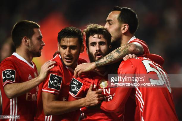Benfica's midfielder Rafa Silva celebrates with his teammates after scoring during the Portuguese league football match SL Benfica vs GD Chaves at...