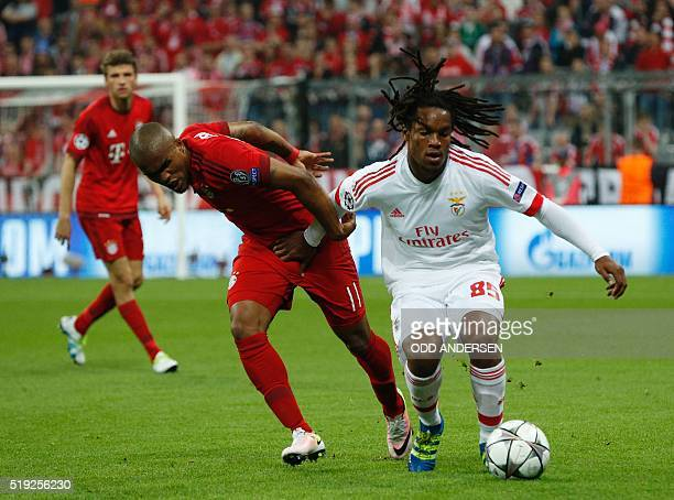 Benfica's midfielder Renato Sanches and Bayern Munich's Brazilian midfielder Douglas Costa vie for the ball during the Champions League quarterfinal...