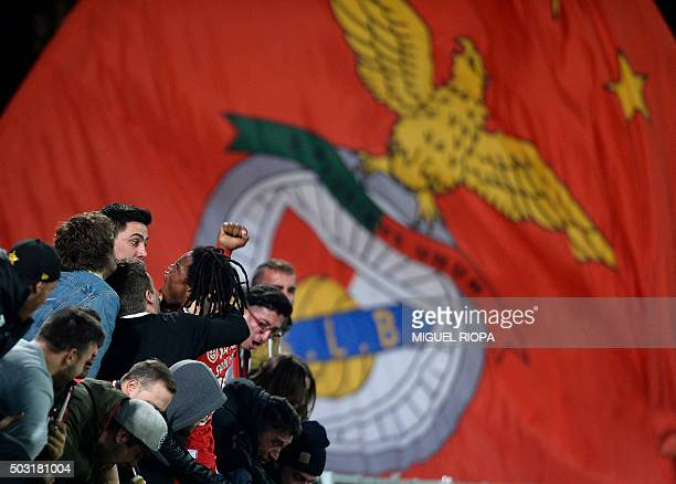 Benfica's midfielder Renato Sanches celebrates with supporters after scoring a goal during the Portuguese league football match Vitoria SC vs SL...