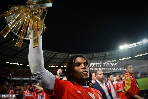 Benfica's midfielder Renato Sanches holds the trophy as he celebrates with teammates after winning the Portuguese League Cup final football match CS...