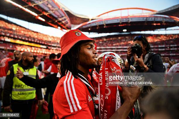 Benfica's midfielder Renato Sanches poses for a photo with the trophy as he celebrates Benfica's 35th Portuguese league title at the end of the...