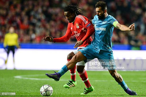 Benfica's midfielder Renato Sanches vies with Zenit's Portuguese midfielder Danny Gomes during the UEFA Champions League round of 16 football match...