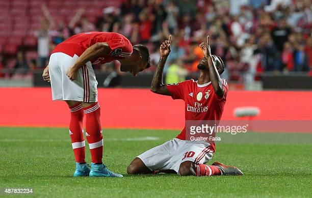Benfica's midfielder Talisca celebrates with teammate Andreas Samaris after scoring a goal during the Primeira Liga match between SL Benfica and Os...