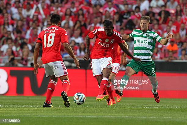 Benfica's midfielder Talisca tries to pass trough Sporting's midfielder Adrien Silva during the Primeira Liga match between SL Benfica and Sporting...