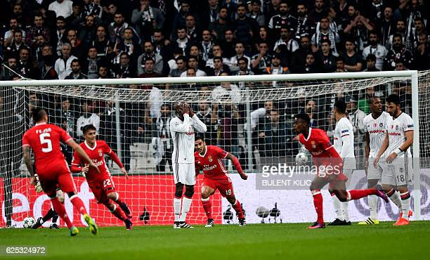 Benfica's Nelson Semedo celebrates with teammate Ljubomir Fejsa and Franco Cervi after scoring against Besiktas as Besiktas' Atiba Hutchinson reacts...