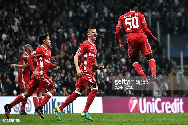 Benfica's Nelson Semedo celebrates with teammates after scoring a goal during the UEFA Champions League Group B football match between Besiktas...