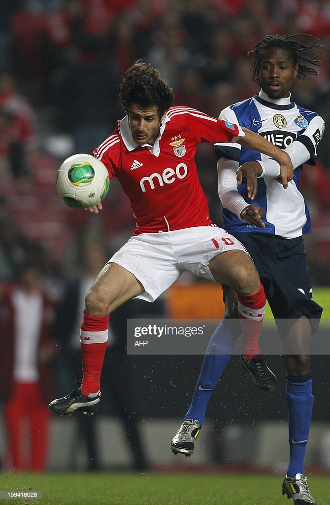 SL Benfica´s Pablo Aimar (L) vies with Porto's Senegalese defender Abdoulaye Ba (R) during the Portuguese league football match SL Benfica vs FC Porto at Luz Stadium in Lisbon on January 13, 2013.