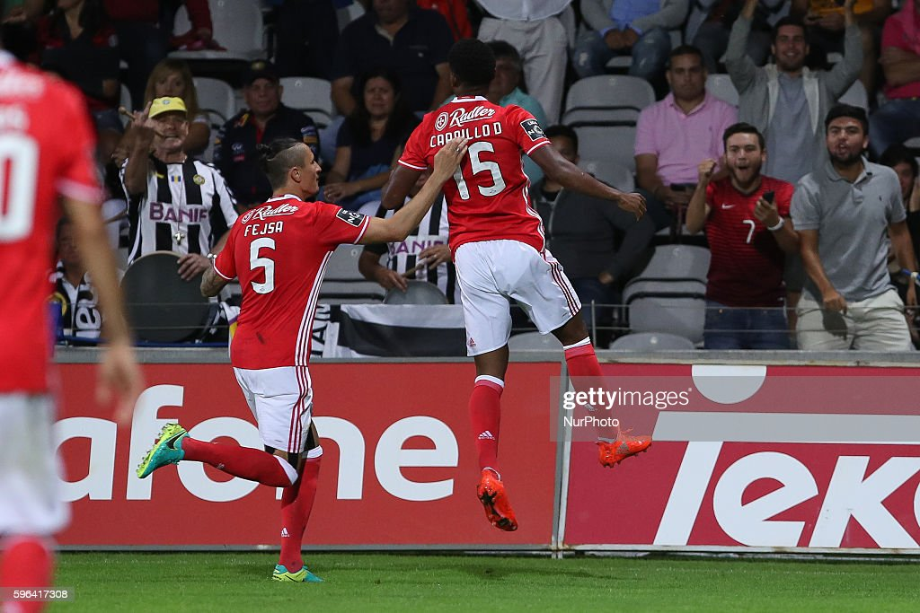 Benfica's Peruvian forward Andre Carrillo celebrates after scoring a goal with Benfica's Serbian midfielder Ljubomir Fejsa during Premier League...