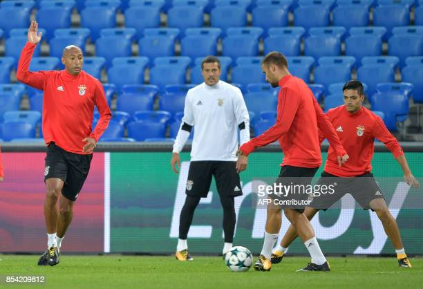 Benfica's players Brazilian defender Luisao Brazilian goalkeeper Julio Cesar Swiss forward Haris Seferovic and Mexican forward Raul Jimenez play...