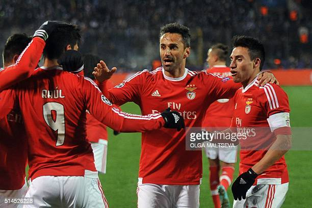 Benfica's players celebrate a goal during the secondleg round of 16 UEFA Champions League football match FC Zenit vs SL Benfica at the Petrovsky...