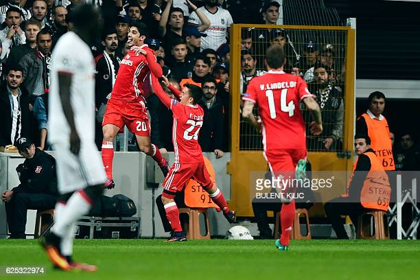 Benfica's players celebrate after scoring a goal during the UEFA Champions League group B football match between Besiktas and Benfica on November 23...