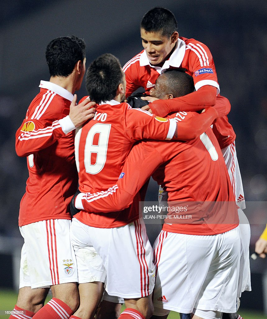 Benfica's players celebrate after scoring during the UEFA Europa league round of 16 football match Bordeaux vs Benfica on March 14, 2013 at the Chaban-Delmas stadium in Bordeaux, southwerstern France. AFP PHOTO /JEAN PIERRE MULLER