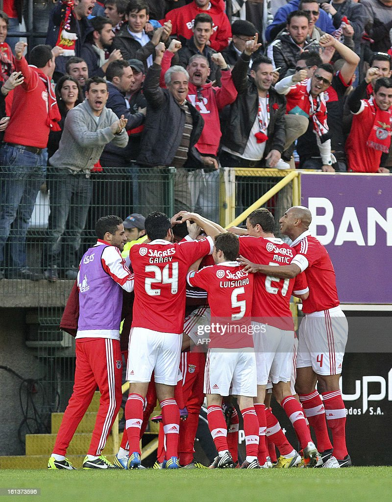 Benfica's players celebrate after Uruguayan midfielder Urreta scored a goal during the Portuguese league football match Nacional vs Benfica at Madeira stadium in Funchal on February 10, 2013.