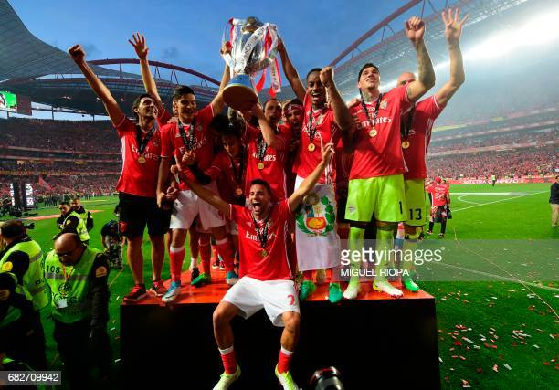 Benfica's players celebrate their 36th title at the end of the Portuguese league football match SL Benfica vs Vitoria Guimaraes SC at the Luz stadium...