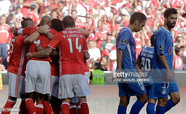 Benfica's players celebrate their goal during the Portuguese league football match SL Benfica vs CD Feirense at the Luz stadium in Lisbon on October...