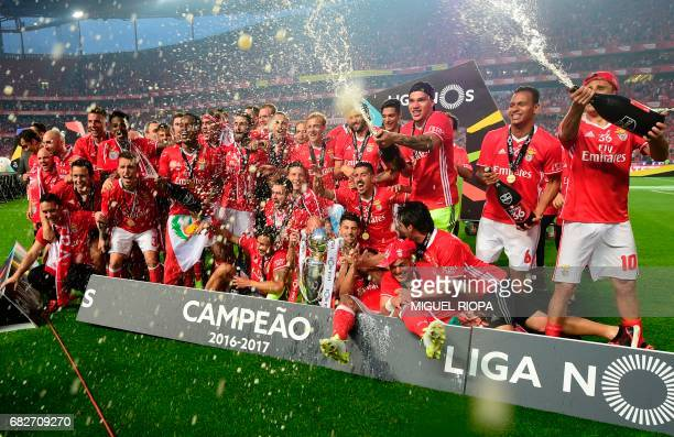 Benfica's players celebrate their Portuguese League trophy after winning their 36th title at the end of the Portuguese league football match SL...