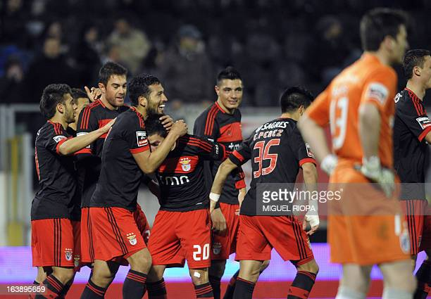 Benfica's players celebrate their second score during the Portuguese league football match Vitoria Guimaraes SC vs SL Benfica at the Afonso Henriques...