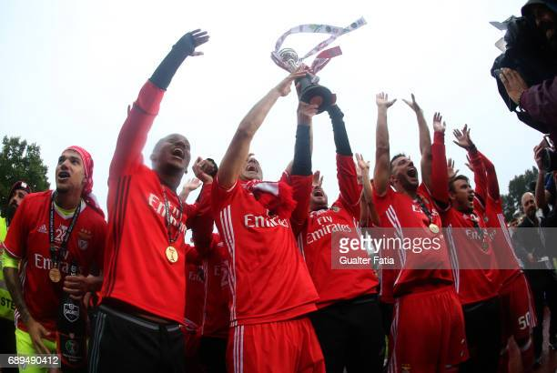 Benfica's players celebrate with trophy after winning the Portuguese Cup Title at the end of the Portuguese Cup Final match between SL Benfica and...