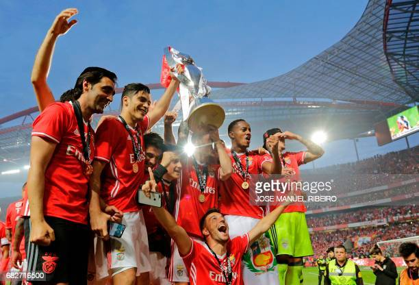 Benfica's players hold the cup after winning their 36th title at the end of the Portuguese league football match SL Benfica vs Vitoria Guimaraes SC...